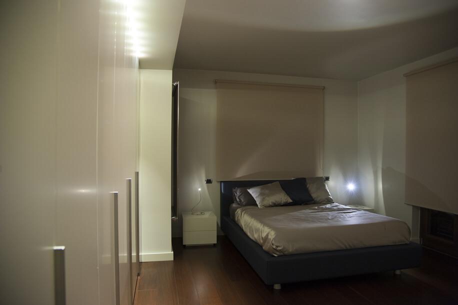 camera da letto in progetto di villa unifamiliare